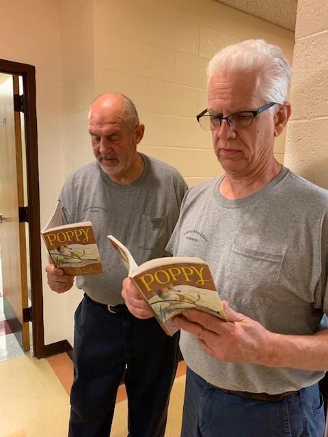 Custodial workers reading poppy