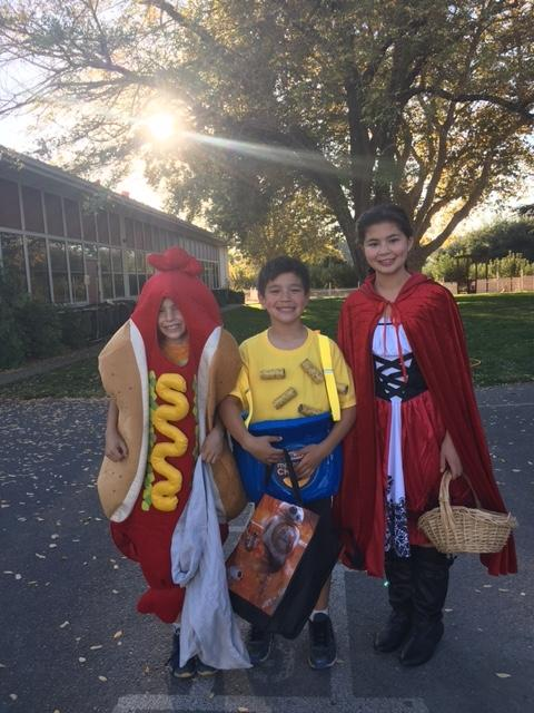 children decorated as hot dog, mac and cheese and little red riding hood