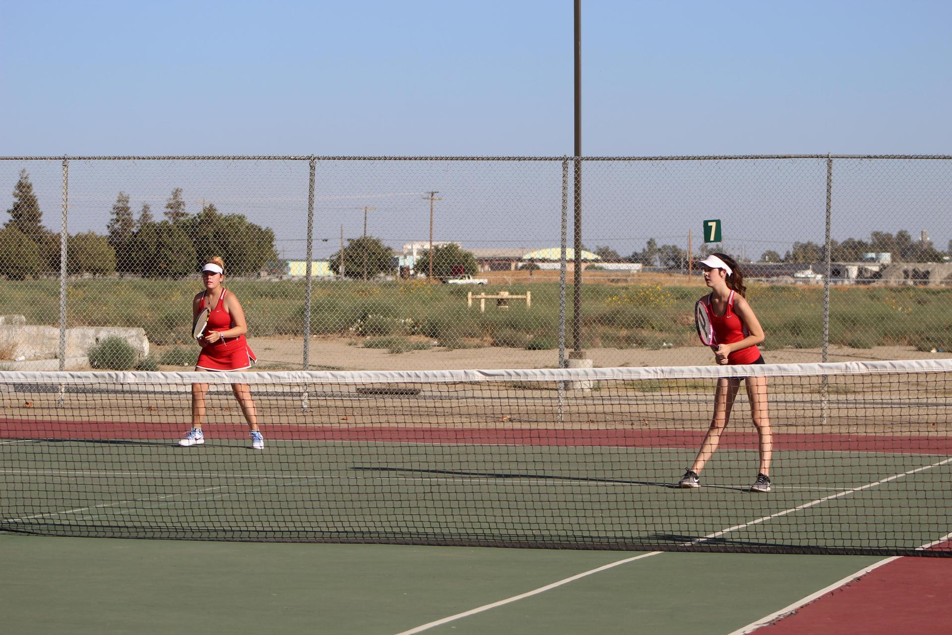 Girls playing tennis against Kerman