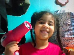 girl holding blow dryer