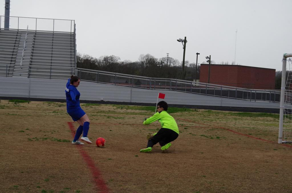 2018 HHS Soccer - Goalie blocking shot