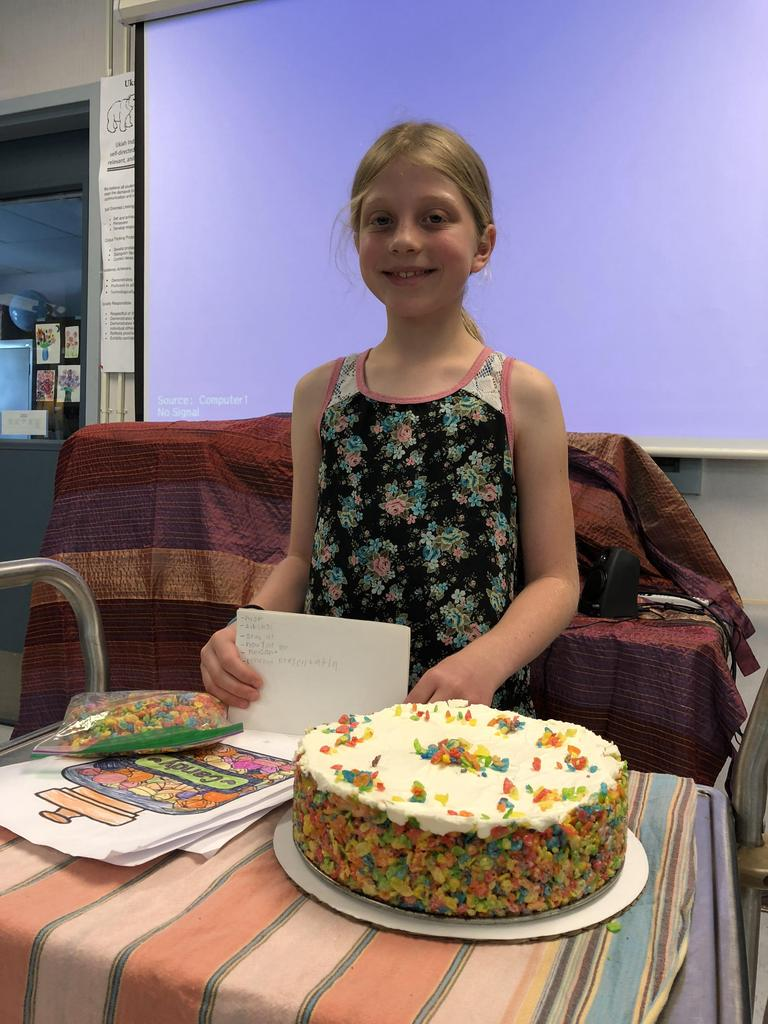 Student displaying deserts she made.