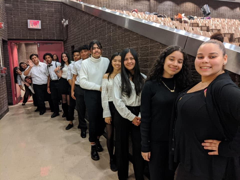 students lined up in auditorium