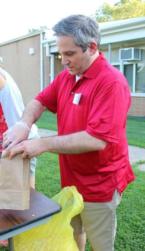 Jefferson School parent scoops popcorn at Summer Social.