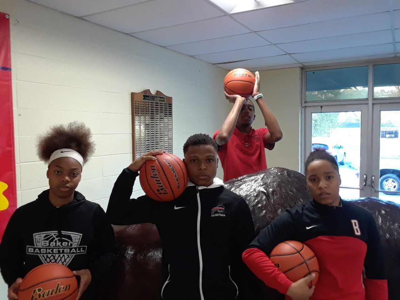 A photo of the 4 basketball athletes from Baker High who will participate in the Louisiana NAACP EBR All Star Game