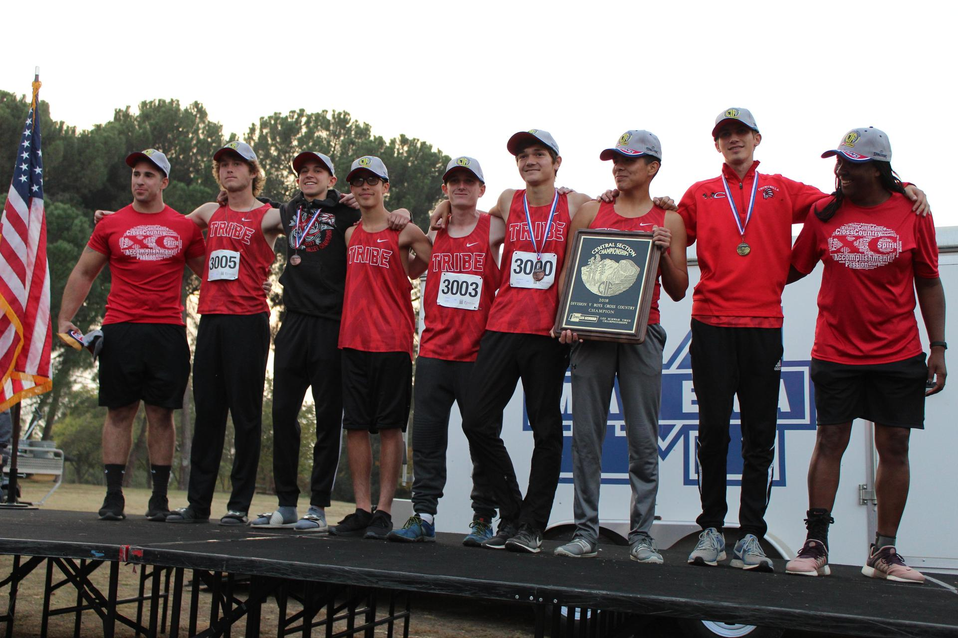Boys runners and their coaches receiving the D-5 Championship Trophy.