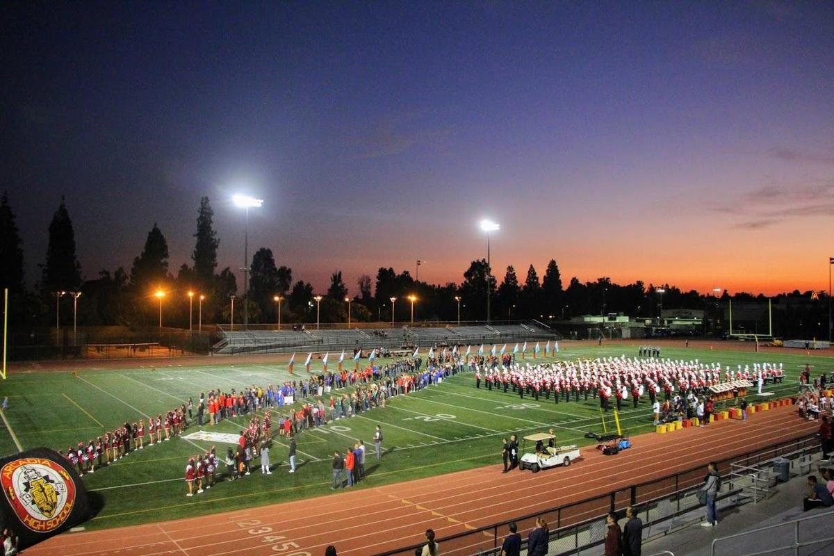 Arcadia High football field lined with staff and band