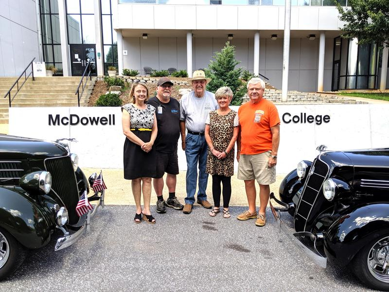 Route 70 cruisers present scholarship funds to college