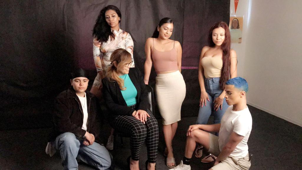 Students from LA CAUSA pose for a photo after getting makeovers