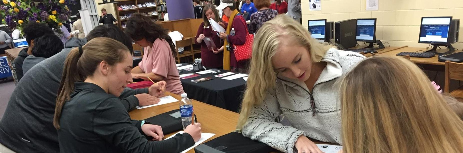 Students filling out applications at Jackson County's College and Scholarship Night held at MHS on December 4, 2018.
