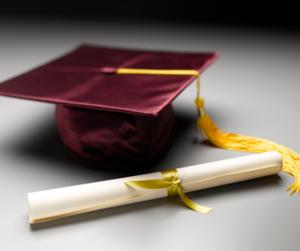 maroon cap and diploma