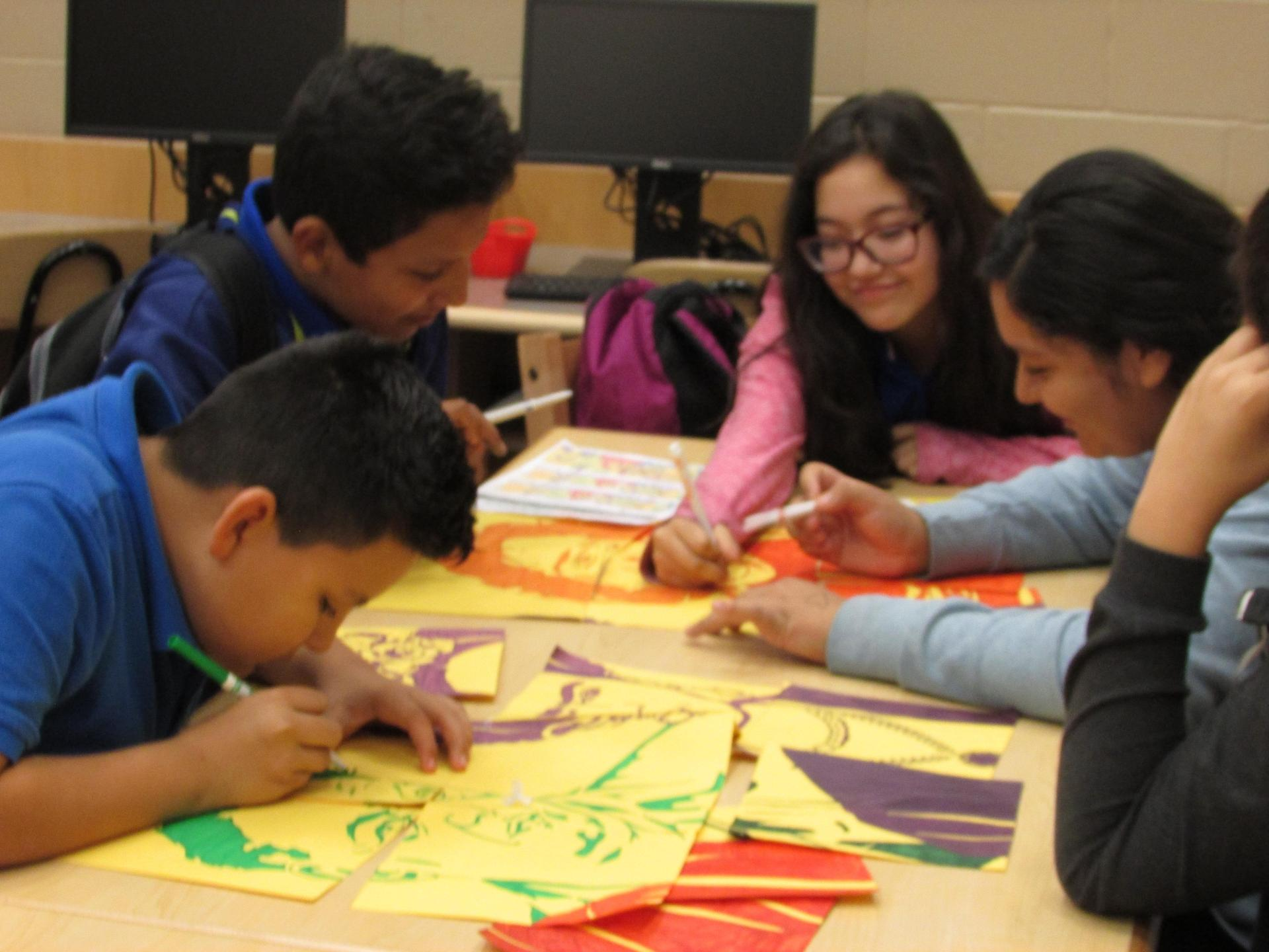 Students working on Hispanic Heritage Collaboration poster.