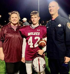 Gage Dunivan with parents