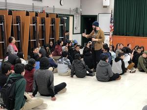 Magician Wayne interacting with students.