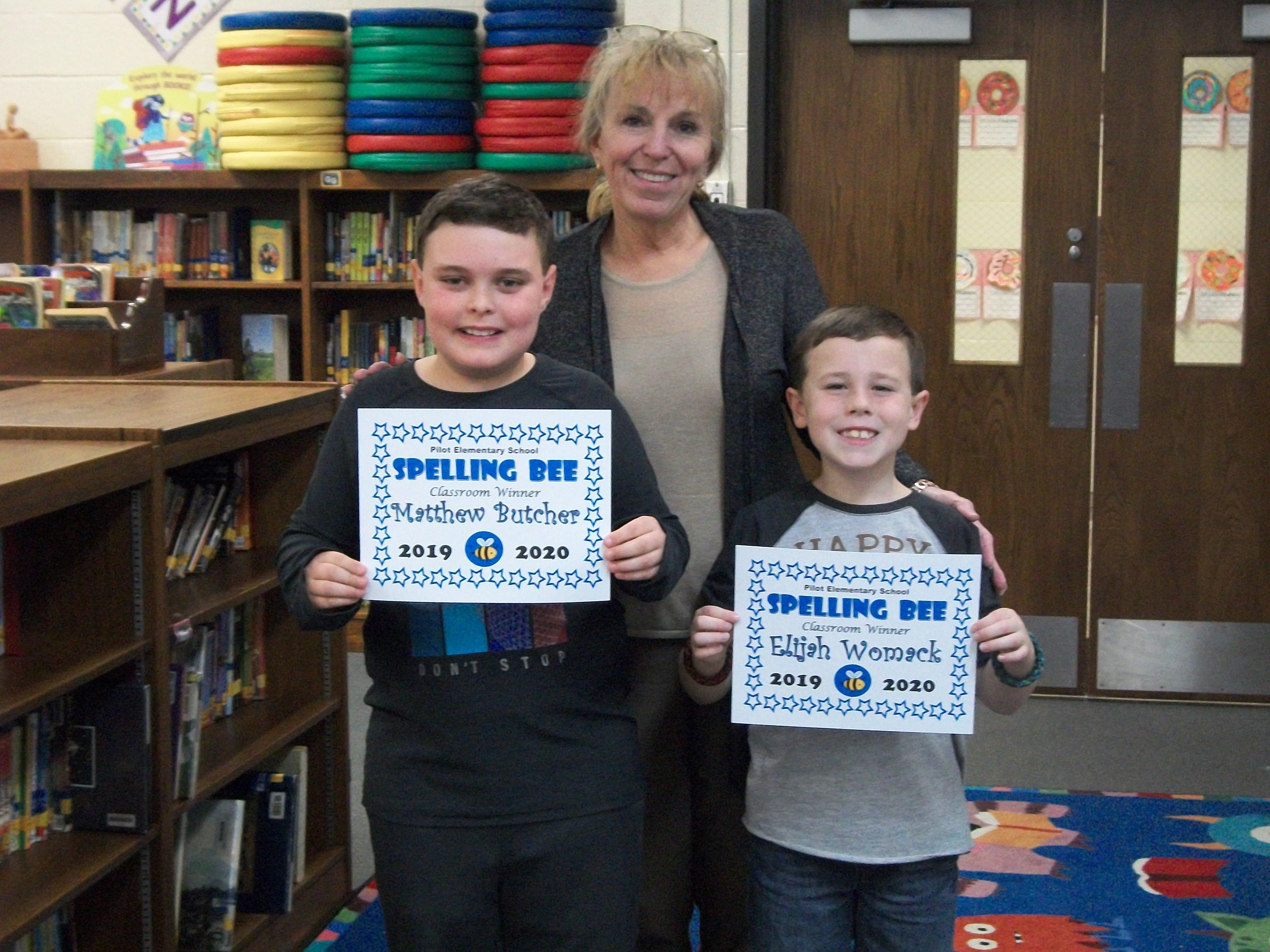 Spelling Bee winner and runner-up with Dr. Hall.