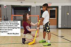 "Image of a teacher helping a blind student learn about hockey. ""Teachers have three loves: love of learning, love of learners, and the love of bringing the first two together."" - Scott Hayden"