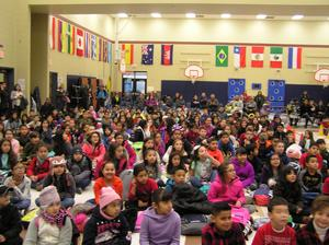 Students listening to morning assembly.