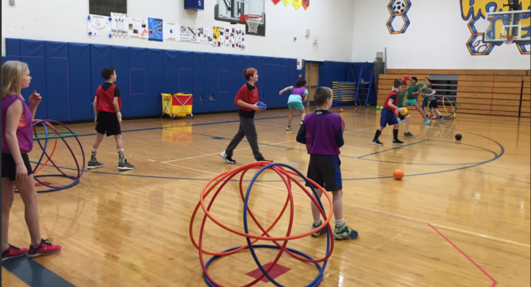 Children playing with hoops in gym