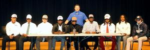 Brunswick High's newest group of signed collegiate football players.