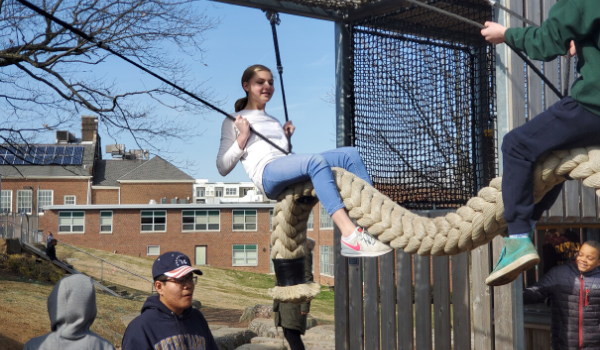 Students on rope swing.