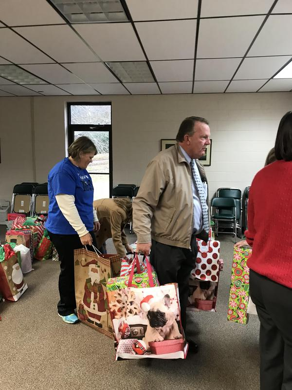 Mr. Barlow and Marsha Emerton helping distribute presents
