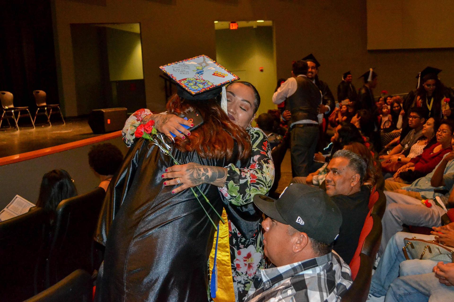 Lennox grad hugs a family member