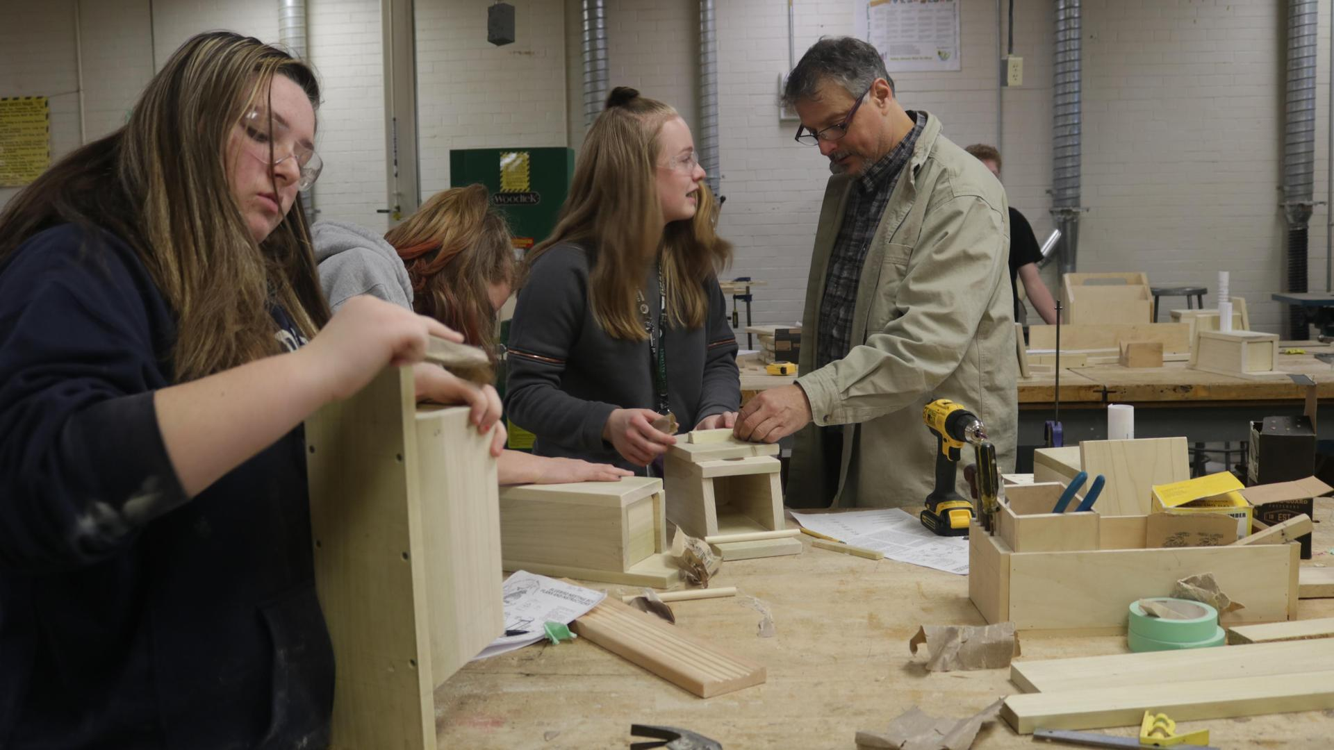 Students building with wood