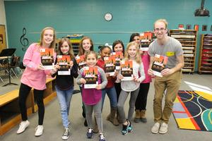 From left to right are B-L Elementary School students Jessie Eidson, Natasha Maroney, Cailyn McCleskey, Sofia Moreno, McKenzie Dozier, Addy Ruff, Ella Cook and Cameron Asbill.  They are pictured here with David LaTorre, an acting coach, as they rehearse for Annie Jr.