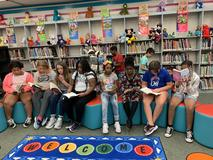 Fourth grade students are reading in the library