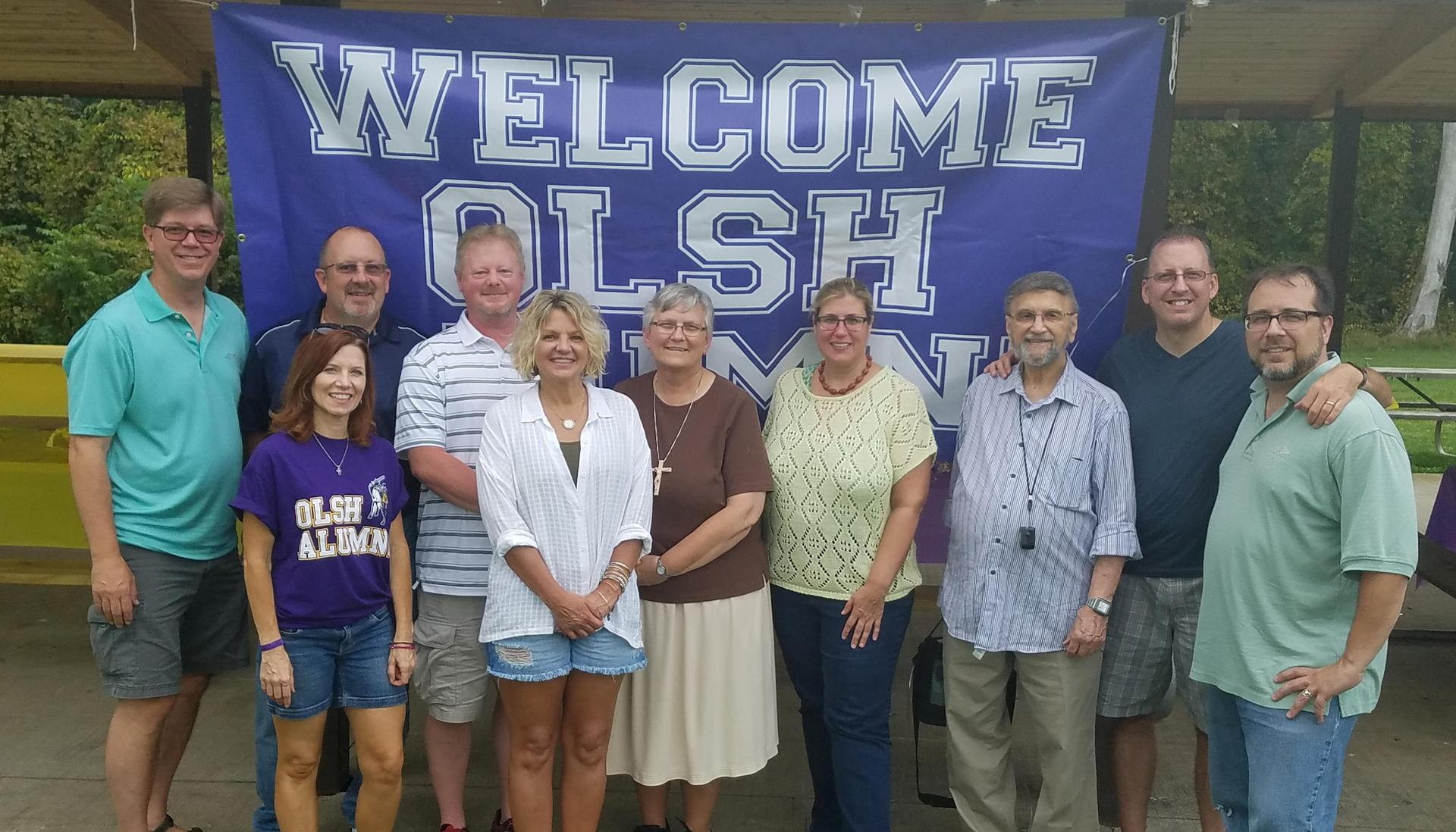 Members of the OLSH class of 1987 pose with Sr. Francine and Mr. M at their reunion