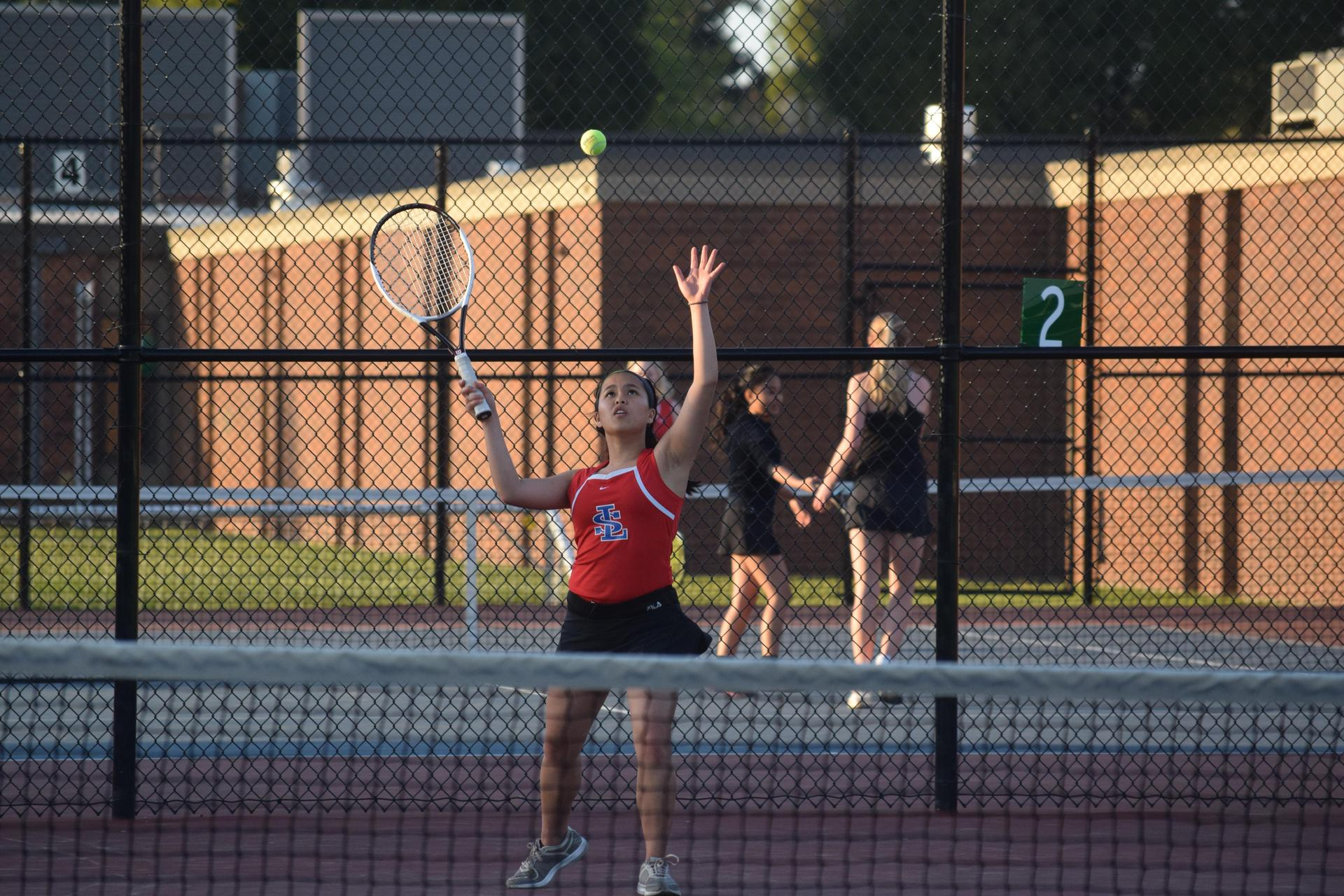 girls tennis hitting a return