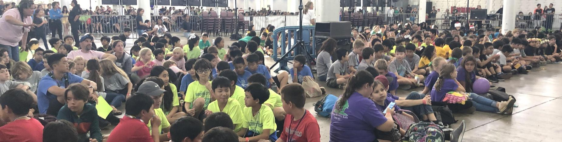 Kilauea Robotics Kid in purple shirts sit in the front row awaiting results surrounded by 41 teams!