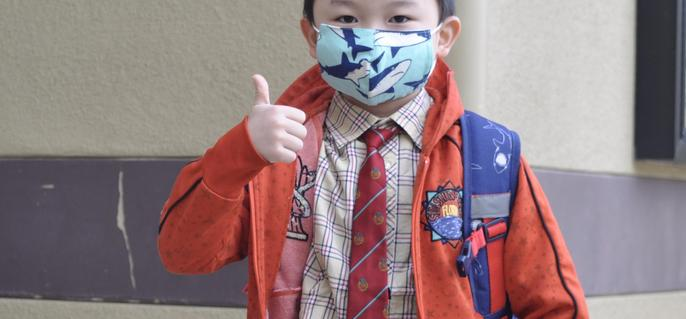 Student Wearing Mask and Giving Thumbs Up
