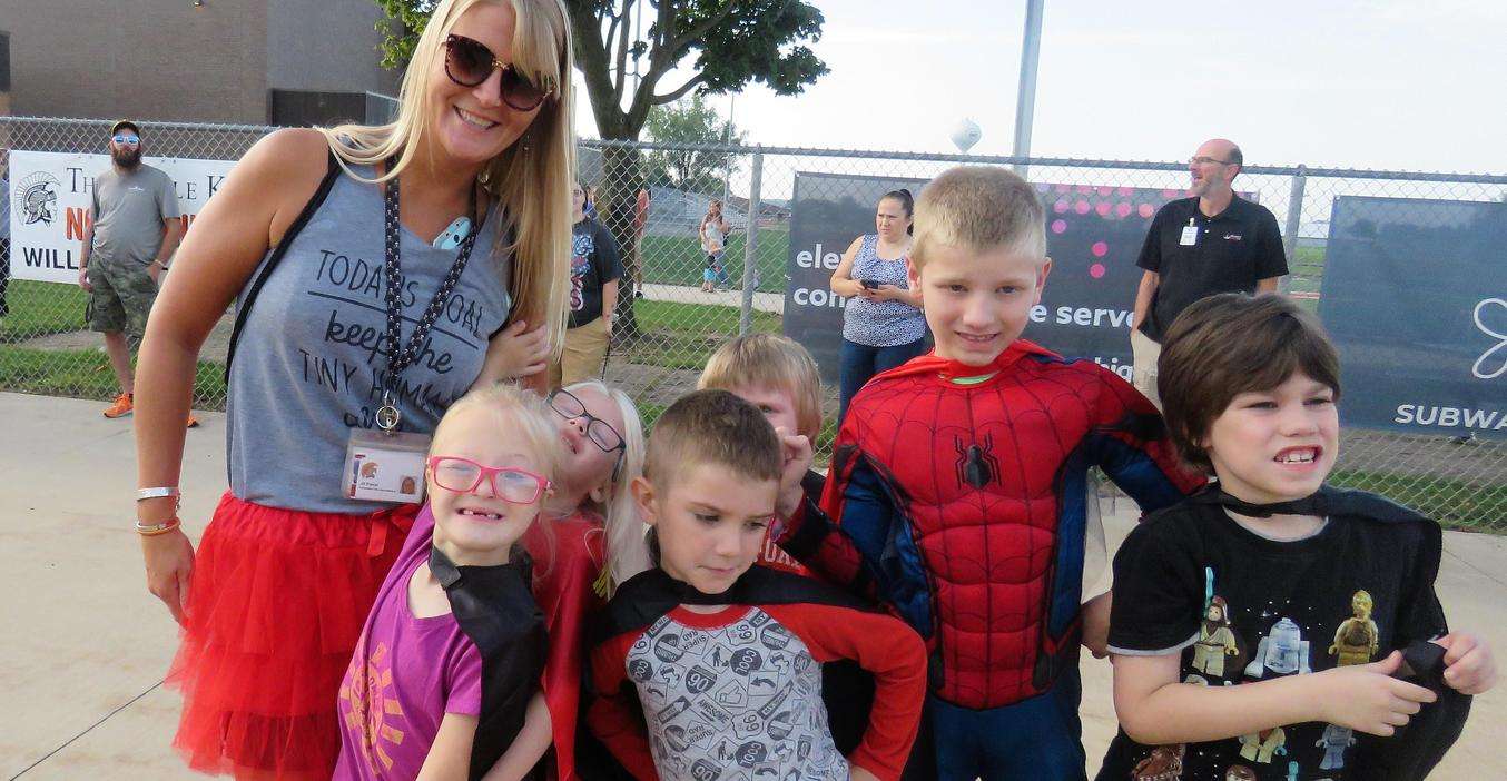 Superheroes get ready to walk at walk-a-thon.