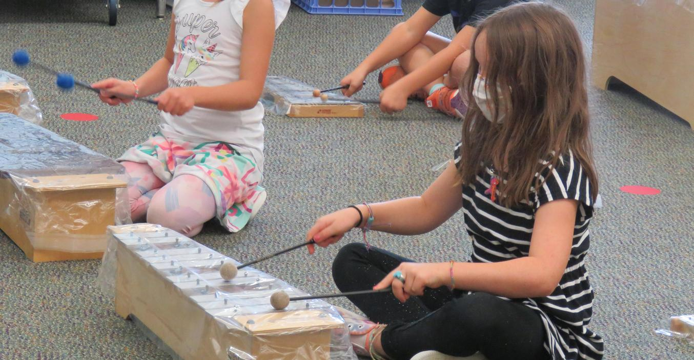 Lee Elementary students enjoy learning to play musical instruments.
