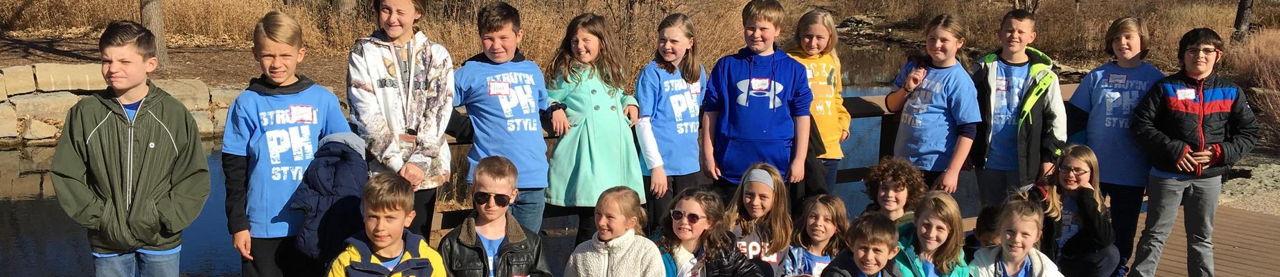 Group of kids outside for fieldtrip