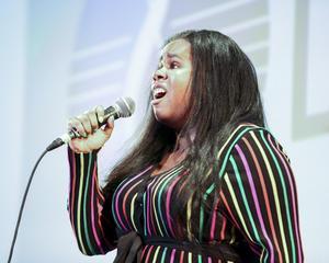 Kalah singing on stage
