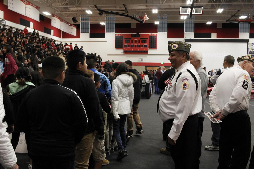 Picture of veteran greeting students