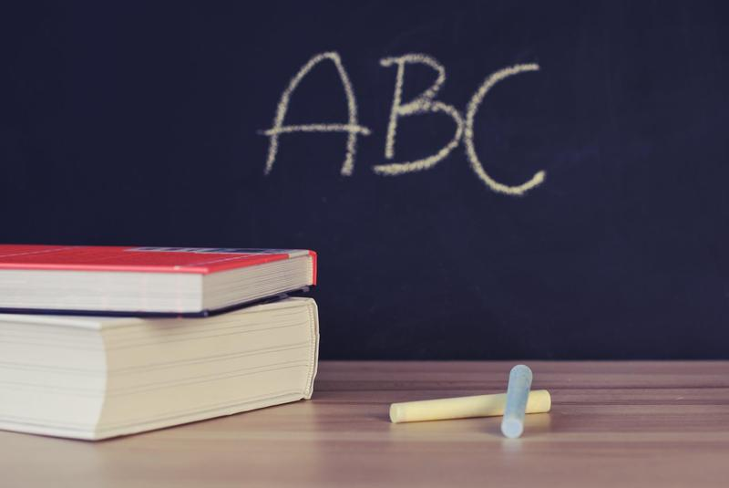 Books in front of chalkboard.