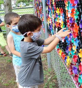 Lincoln students work on playground mosaic.