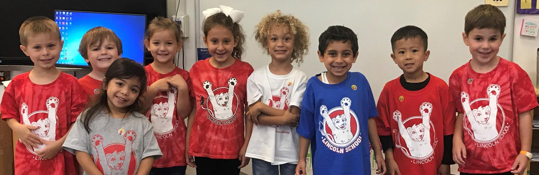 Photo of kindergartners wearing spirit wear shirts on Spirit Day.