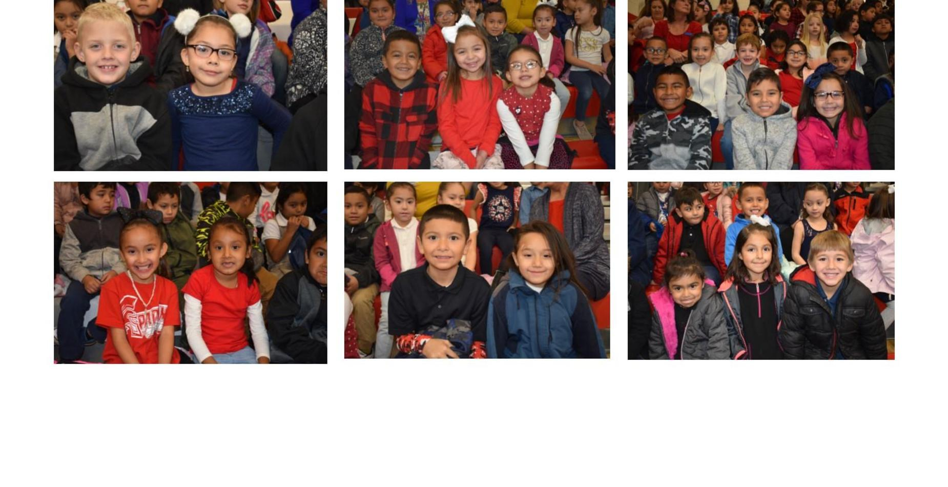 Some of our first and kindergarten students wearing red, white, and blue at our veterans assembly.