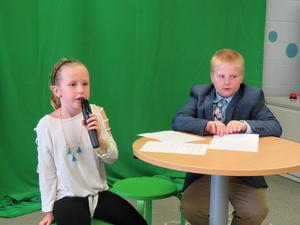 Lee Elementary students become TV news broadcasters as they  deliver the Lee news.