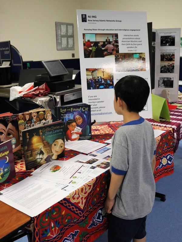 Photo of a Tamaques 1st grader looking at one of the displays at the celebration of cultural diversity at WHS on May 2.