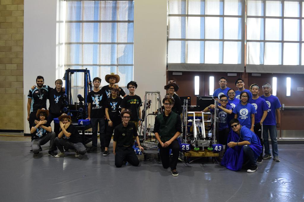 Alliance group picture with robots