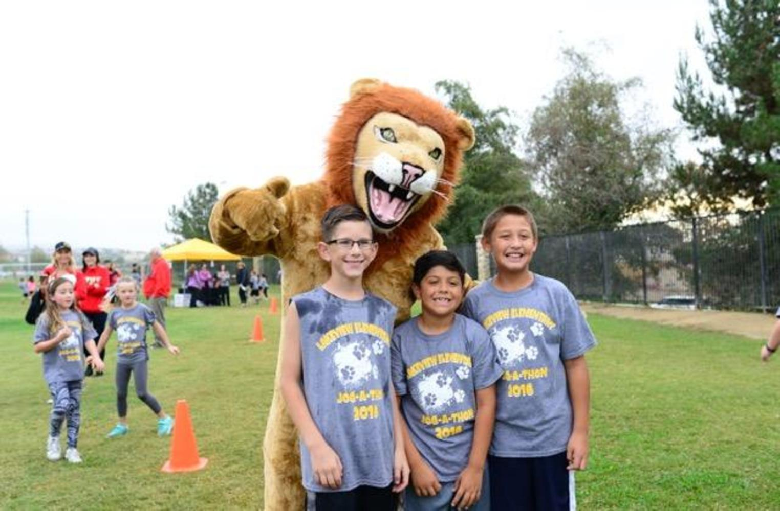 past jog-a-thon runners with lion mascot