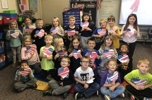 Mrs. Staeven's 1st grade class holding up their cards