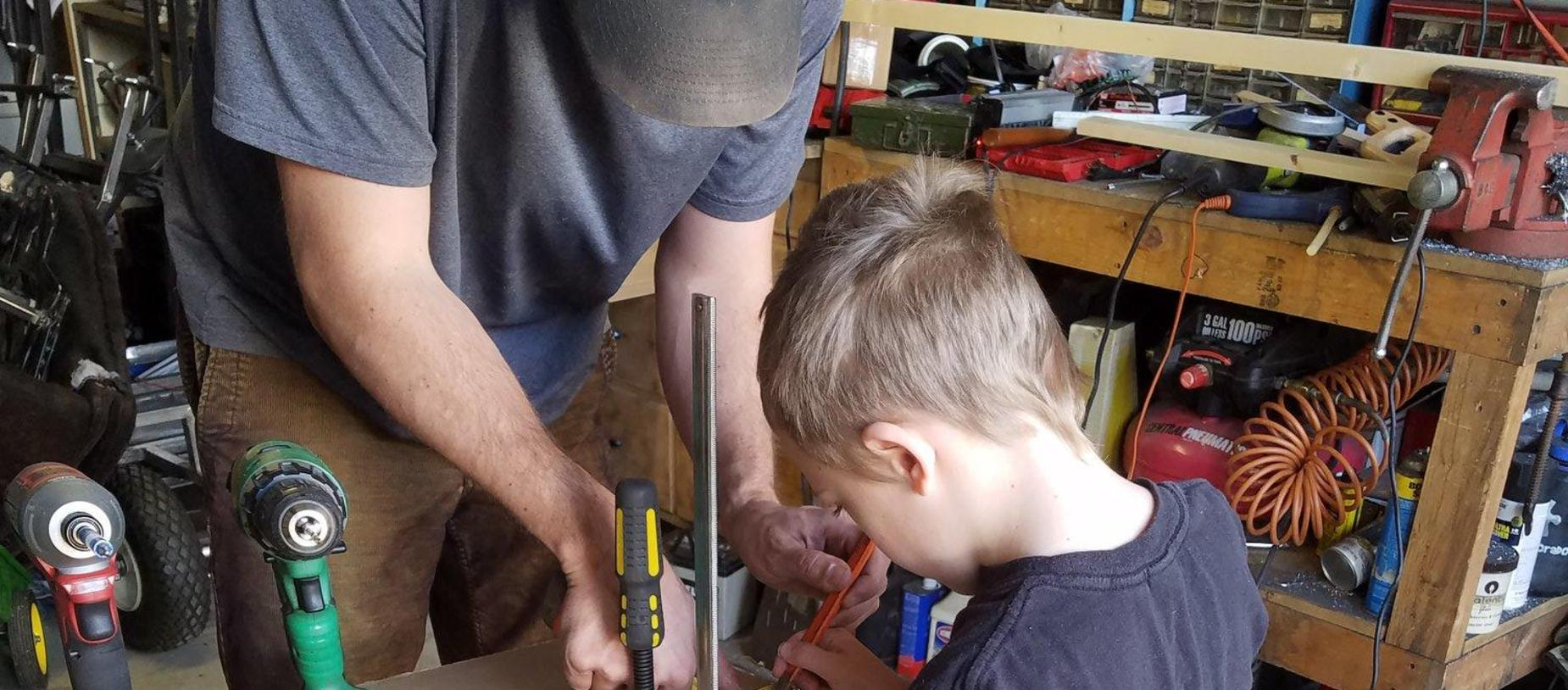 Student Making a Pinball Machine with his Dad During Remote Learning