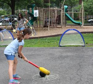 Student at Wilson School aims for goal as she enjoys Field Day.