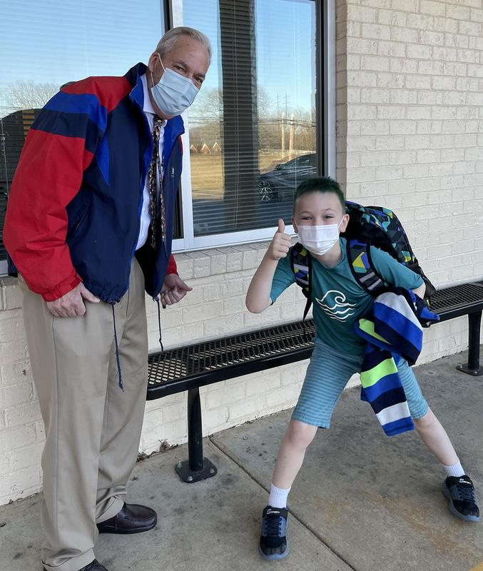 A side-benefit of in-person instruction, this young man shares a new joke with Mr. York each morning at carpool.
